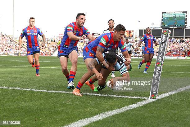 Sosaia Feki of the Sharks scores a try during the round 10 NRL match between the Newcastle Knights and the Cronulla Sharks at Hunter Stadium on May...