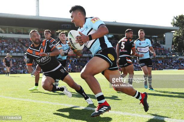 Sosaia Feki of the Sharks scores a try during the round 25 NRL match between the Wests Tigers and the Cronulla Sharks at Leichhardt Oval on September...