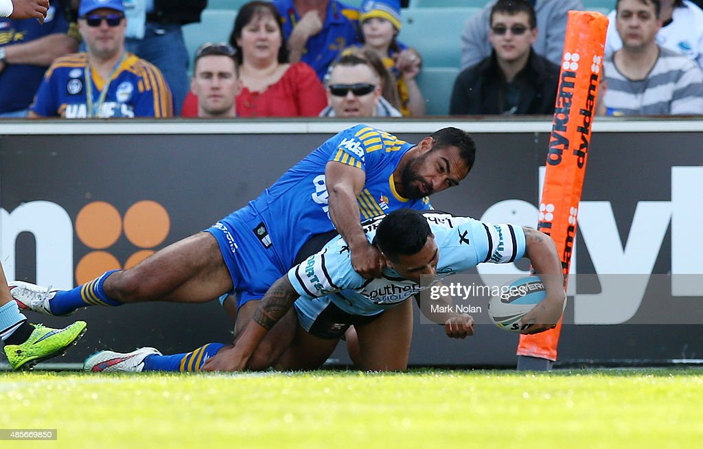 Sosaia Feki of the Sharks scores a try during the round 25 NRL match between the Parramatta Eels and the Cronulla Sharks at Pirtek Stadium on August 29, 2015 in Sydney, Australia.
