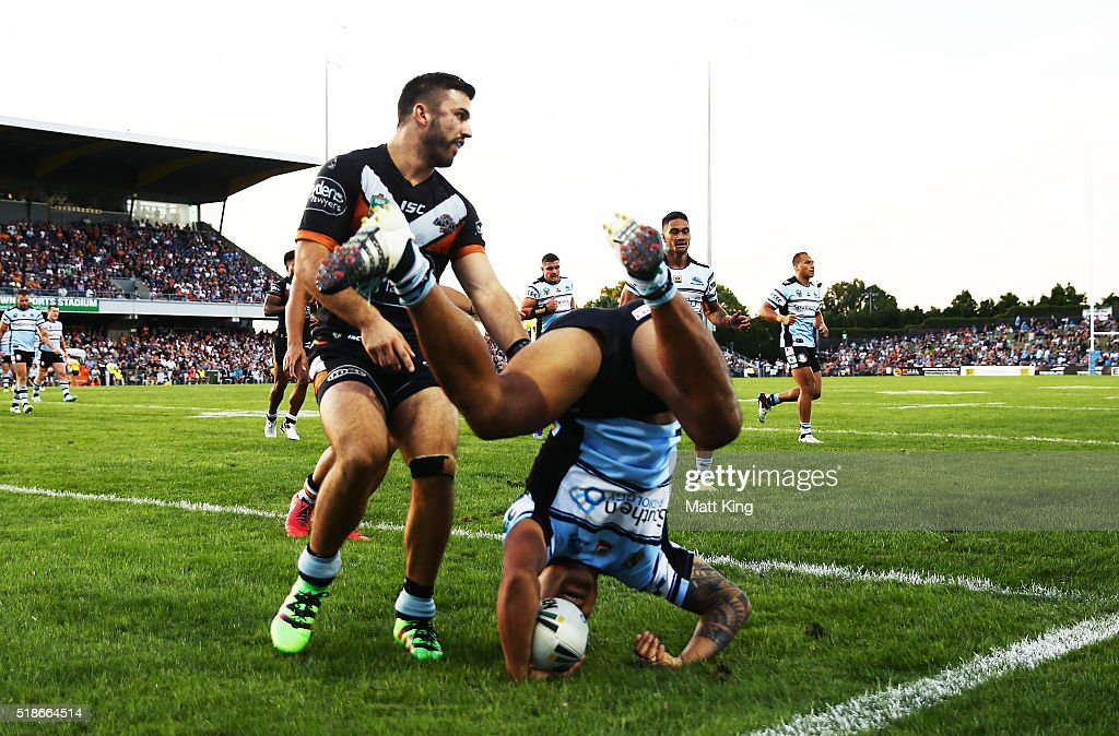 Sosaia Feki of the Sharks scores a try during the round five NRL match between the Wests Tigers and the Cronulla Sharks at Campbelltown Sports Stadium on April 2, 2016 in Sydney, Australia.