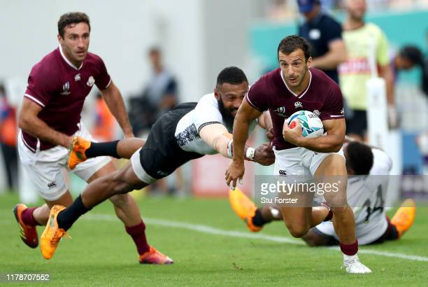 Soso Matiashvili of Georgia escapes the tackle of Waisea Nayacalevu of Fiji during the Rugby World Cup 2019 Group D game between Georgia and Fiji at...
