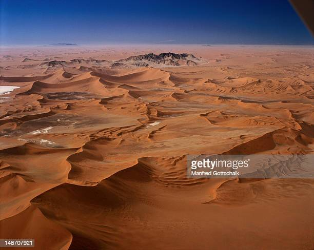 Sossusvlei are huge sand dunes in the Namib-Naukluft Desert Park, they tower up to 200 metres above the valley floor and over 300 metres over the underlying strata