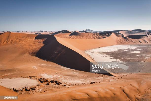 sossusvlei namib desert sand dunes aerial view sea of sand namibia - mlenny stock pictures, royalty-free photos & images