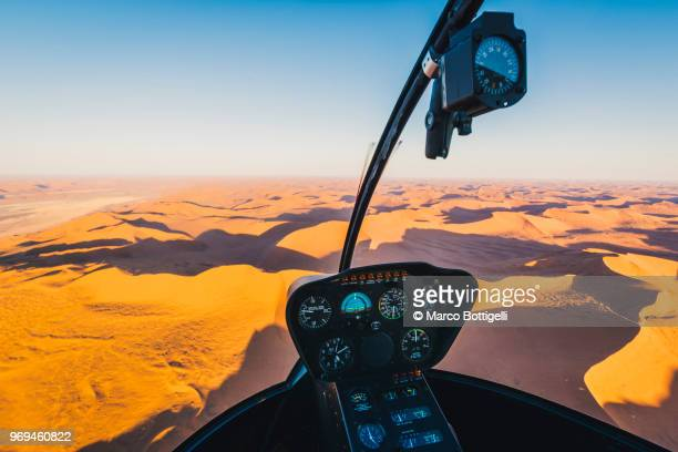 sossusvlei sand dunes seen from helicopter cockpit, namibia - airplane part stock photos and pictures