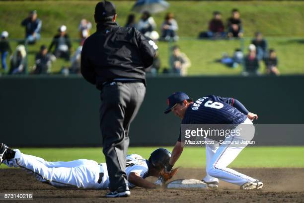 Sosuke Genda of Samurai Japan tags out at second base during the practice game between Japan and Hokkaido Nippon Ham Fighters at Sokken Stadium on...