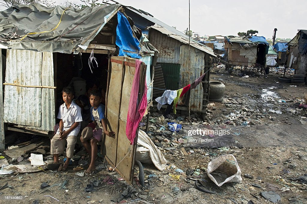 Sot (left) and Mao Meath, both 13, sit in the doorway of their family's shack atop the Steung Meanchey dump on the edge of Phnom Penh. For the last three years since coming to Phnom Penh from Svay Rieng Province with their families, the two have collected recyclable scrap from atop the dump. Says Mao, 'Prey Veng is better. It's not terrible like this.' The vast majority of Cambodian children work. Their labor is imperative for their survival and the survival of their families. In rural areas, kids are expected to work beside their parents on farms. In cities, they are sent out to sell flowers, drinks or shine shoes for extra money. Everywhere, as soon as they are able, children are expected to take care of their younger siblings and take up difficult family chores, work that is usually reserved for parents or servants in the developed world. In Cambodia, kids work everywhere, and form a significant, underreported part of the country's economy..