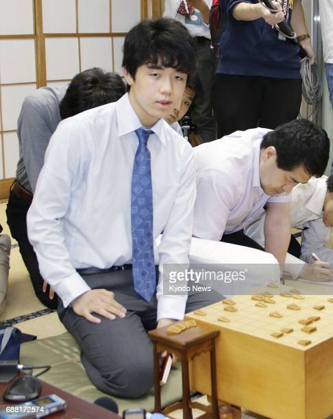 Sota Fujii at 14 the youngest professional player of shogi or Japanese chess beats Seiya Kondo at a match in Tokyo on May 25 extending his record...