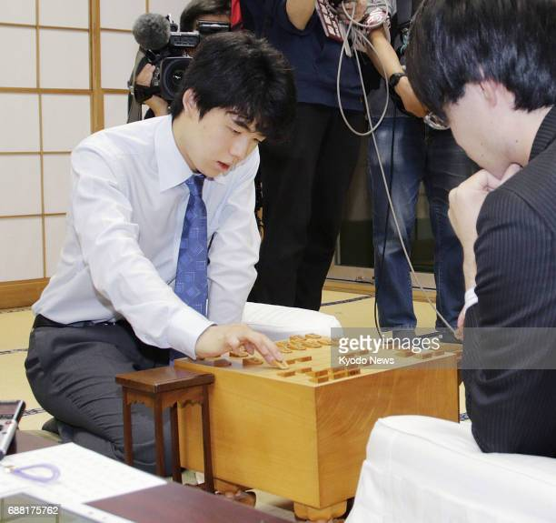 Sota Fujii at 14 the youngest professional player of shogi or Japanese chess reviews a match against Seiya Kondo in Tokyo on May 25 after extending...