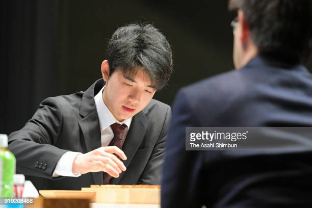 Sota Fujii makes a move against Yoshiharu Habu in their semifinal match of the Asahi Cup competition on February 17 2018 in Tokyo Japan