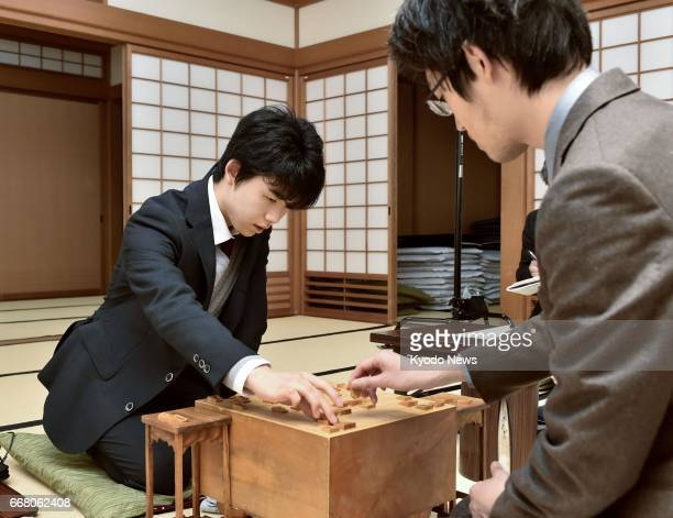 Sota Fujii the youngest professional player of shogi a chesslike Japanese board game beats Yoshitaka Hoshino on April 13 in Osaka extending his own...
