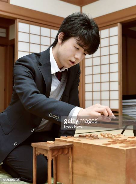 Sota Fujii the youngest professional player of shogi a chesslike Japanese board game reviews a game after beating Yoshitaka Hoshino on April 13 in...