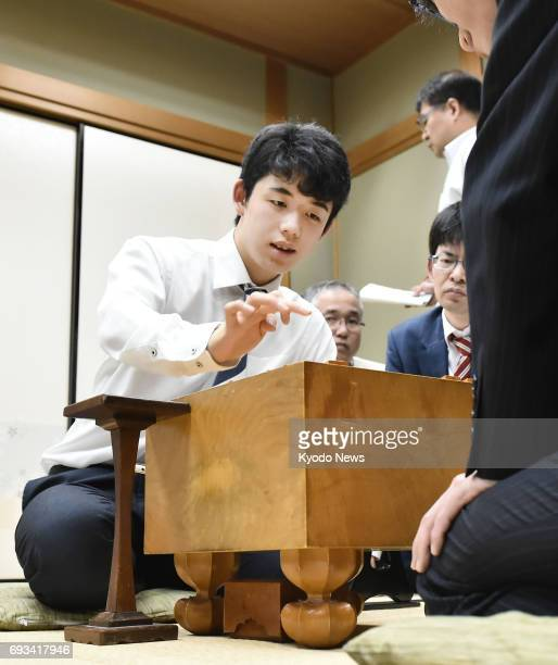 Sota Fujii youngest professional 'shogi' Japanese chess player at 14 reviews a match against Hiroshi Miyamoto in Osaka on June 7 after extending his...