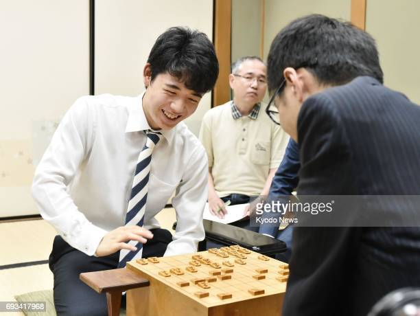 Sota Fujii youngest professional 'shogi' Japanese chess player at 14 smiles while reviewing a match against Hiroshi Miyamoto in Osaka on June 7 after...