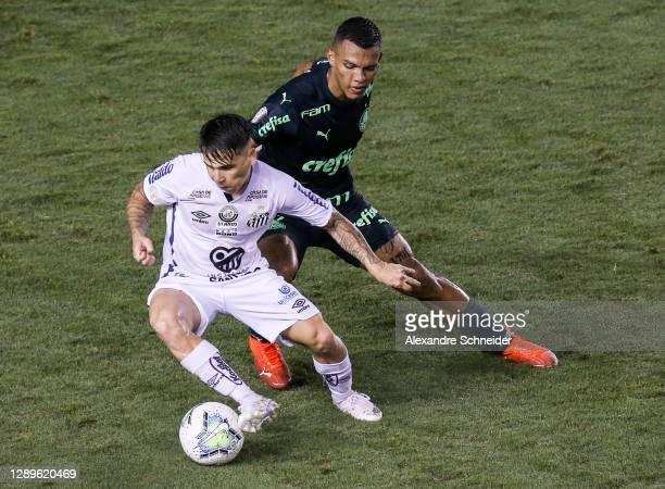 Soteldo of Santos and Gabriel Veron of Palmeiras fight for the ball during the match as part of Brasileirao Series A 2020 at Vila Belmiro Stadium on...