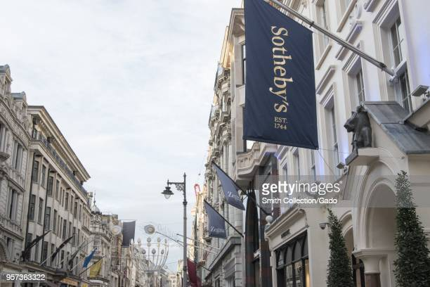 'Sotheby's' and 'Zegna' store buildings decorated with flag banners at the Bond Street London England October 28 2017