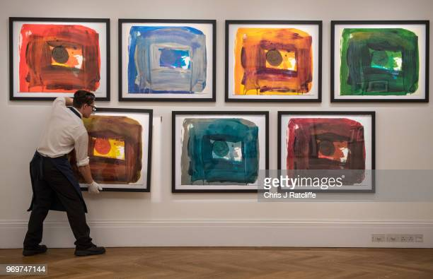 Sotheby's art handler hangs works on paper by Howard Hodgkin from his personal collection on view as part of Sotheby's British Art Week at Sotheby's...