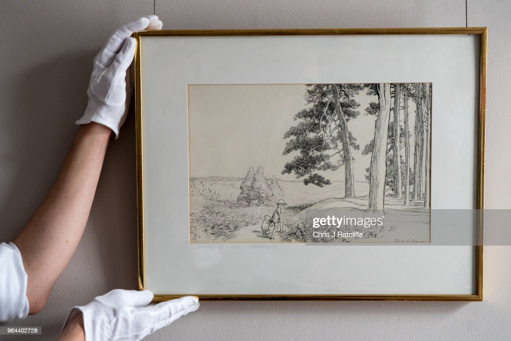 A Sotheby's art handler holds '...an enchanted place on the very top of the Forest' by E.H. Shephard, estimated at £70,000 to £90,000, at the unveiling of original Winnie-The-Pooh sketches at Sotheby's on May 31, 2018 in London, England. The map has been unseen for almost half a century and is up for sale alongside four further long hidden original Winnie-The-Pooh illustrations at Sotheby's London on 10th July 2018.