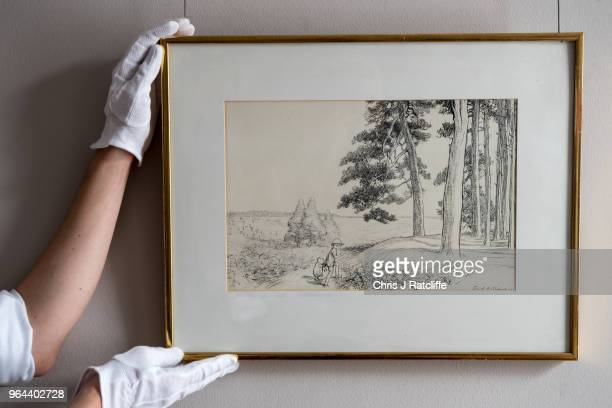 Sotheby's art handler holds 'an enchanted place on the very top of the Forest' by EH Shephard estimated at £70000 to £90 at the unveiling of original...