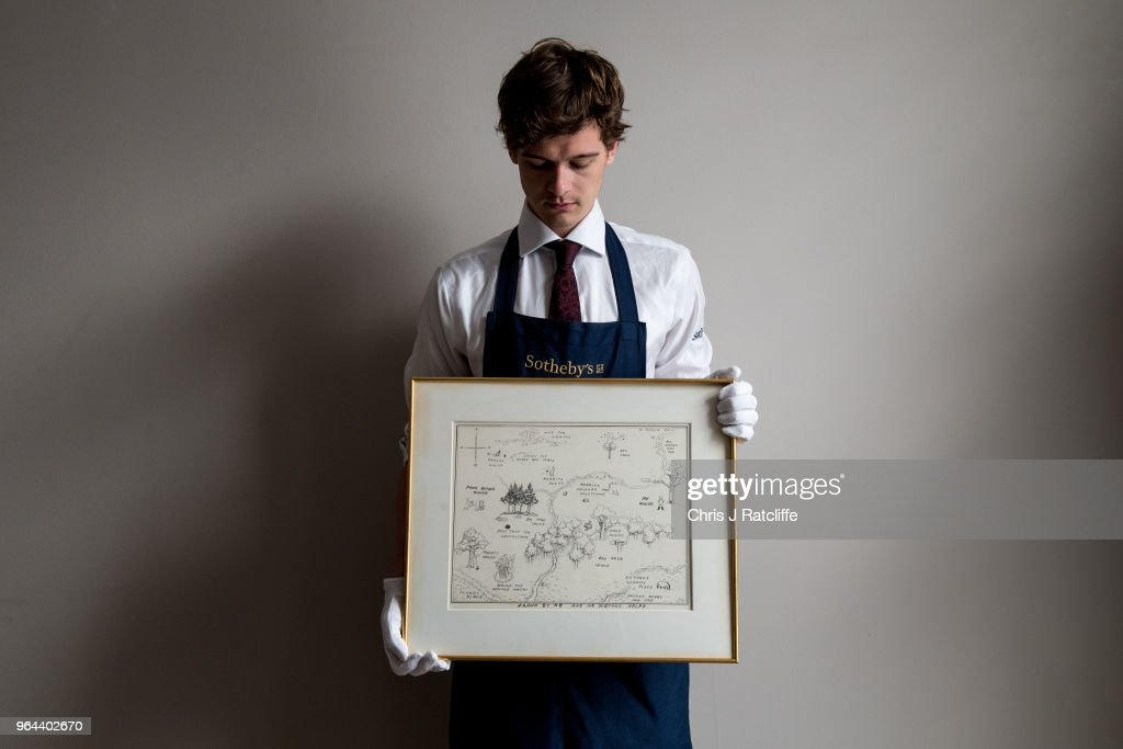 A Sotheby's art handler holds 'The Original Map of the Hundred Acre Wood' by E.H. Shepard, estimated at £100,000 to £150,000, at the unveiling of original Winnie-The-Pooh sketches at Sotheby's on May 31, 2018 in London, England. The map has been unseen for almost half a century and is up for sale alongside four further long hidden original Winnie-The-Pooh illustrations at Sotheby's London on 10th July 2018.
