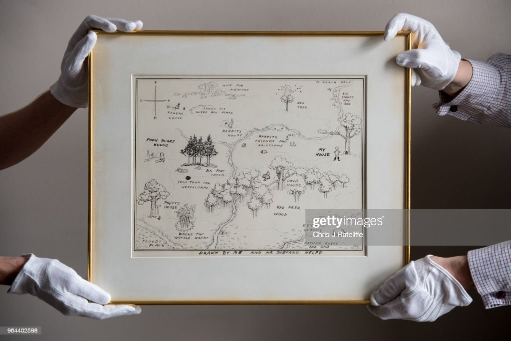 Sotheby's art handlers hold 'The Original Map of the Hundred Acre Wood' by E.H. Shepard, estimated at £100,000 to £150,000, at the unveiling of original Winnie-The-Pooh sketches at Sotheby's on May 31, 2018 in London, England. The map has been unseen for almost half a century and is up for sale alongside four further long hidden original Winnie-The-Pooh illustrations at Sotheby's London on 10th July 2018.