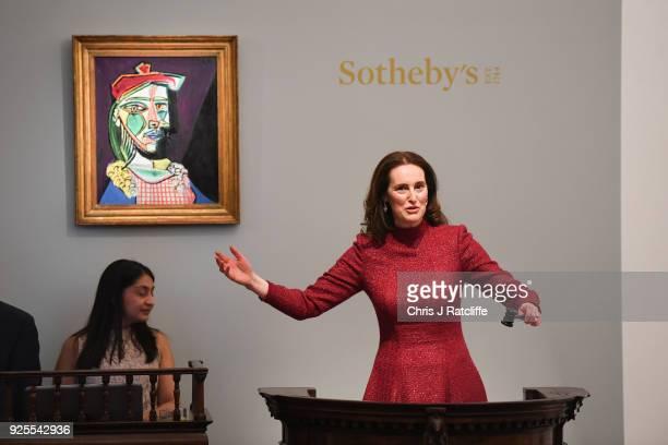 SothebyÕs auctioneer Helena Newman sells Pablo PicassoÕs weeping ÔGolden MuseÕ for GBP498 million during SothebyÕs Impressionist Modern Surrealist...
