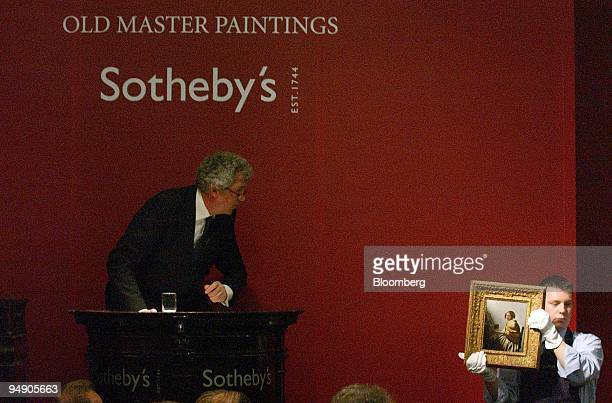 """Sotheby's auctioneer, Henry Wyndham, brings down the hammer on the sale of Vermeer's """"Young Woman Seated at the Virginals"""" at their New Bond Street..."""