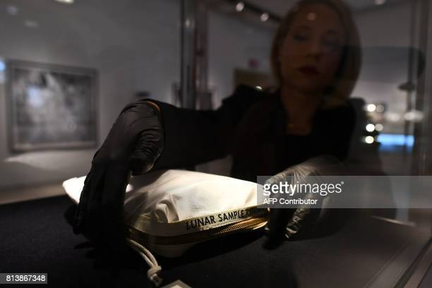 Sothebys Cassandra Hatton adjusts the Apollo 11 Contingency Lunar Sample Return Bag used by Neil Armstrong on Apollo 11 to bring back the very first...