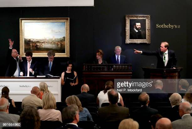 Sotheby's Chairman Harry Dalmeny fields bids at the Old Masters Evening Sale in London which was led by Sir Peter Paul Ruben's powerful Portrait of a...