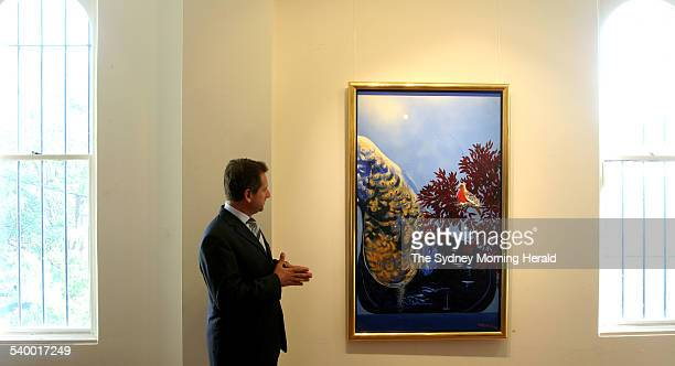 Sotheby's chairman Justin Miller with Brett Whiteley's painting 'Dove at Dusk' during a press call before theh painting is auctioned in Melbourne on...