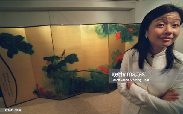 Sotheby's chinese painting specialist Evelyn Lin gives media a briefing October 2 on Chinese master Zhang Daqian's 6'X12' Crimson Lotuses on Golden...