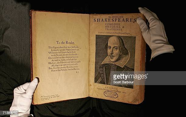 Sothebys employee handles a copy of William Shakespeare The First Folio 1623 on July 7 2006 in London England The most important book in English...