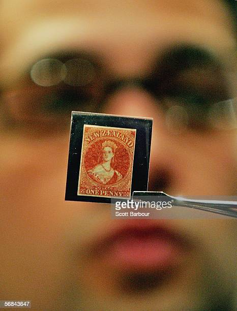 Sotheby's employee holds a 1855 Perkins, Bacon & Co. Watermark Large Star Imperforate One Penny stamp which is expected to fetch between...