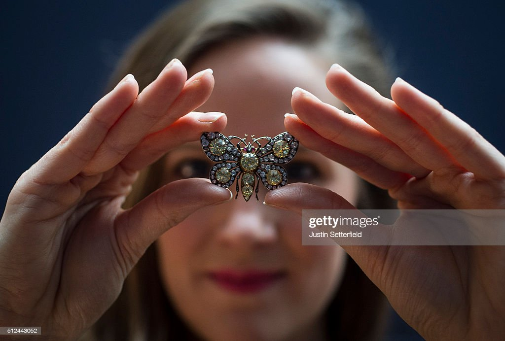 A Sotheby's employee holds a diamond and ruby butterfly Brooch, circa 1880 with an estimated auction value of £25,000-35,000, during the pre-auction preview of the personal collection of Deborah Cavendish, Duchess of Devonshire at Sotheby's on February 26, 2016 in London, England. The youngest of the Mitford Sisters, and for half a century the chatelaine of Chatsworth, one of Englands greatest stately homes, Deborah Cavendish, Duchess of Devonshire was at the very heart of British rural, cultural and political life. The exhibition of her collection opens to the public on February 27, and the sale takes place on March 2, 2016.