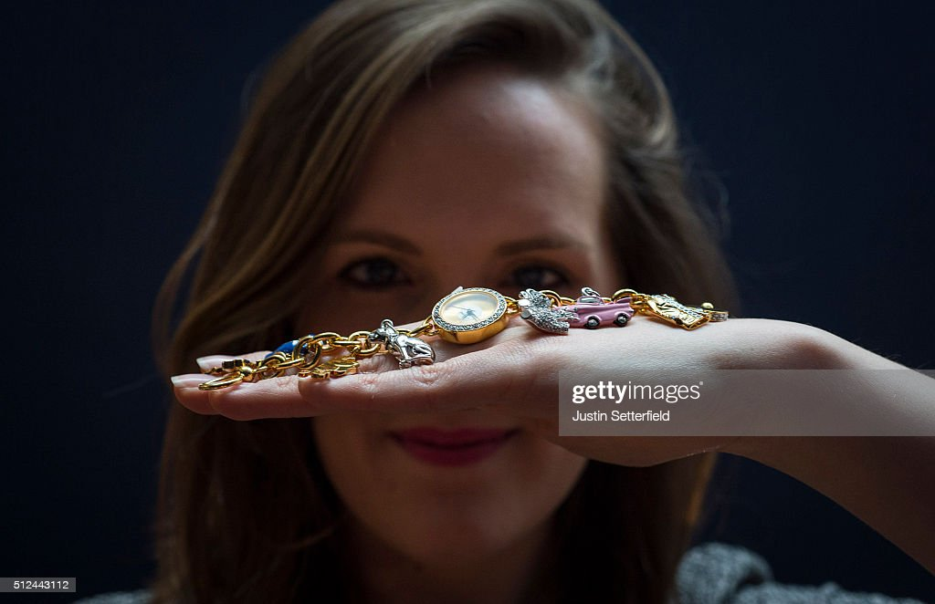 A Sotheby's employee holds an Elvis themed watch bought in Graceland which is part of The Duchess collection of Elvis Presley ephemera during the pre-auction preview of the personal collection of Deborah Cavendish, Duchess of Devonshire at Sotheby's on February 26, 2016 in London, England. The Duchess' Elvis Presley collection, including a novelty Elvis telephone, was previously installed in the Blue Drawing Room at Chatsworth and has an estimated auction value of £500-1,000. The youngest of the Mitford Sisters, and for half a century the chatelaine of Chatsworth, one of Englands greatest stately homes, Deborah Cavendish, Duchess of Devonshire was at the very heart of British rural, cultural and political life. The exhibition of her collection opens to the public on February 27, and the sale takes place on March 2, 2016.