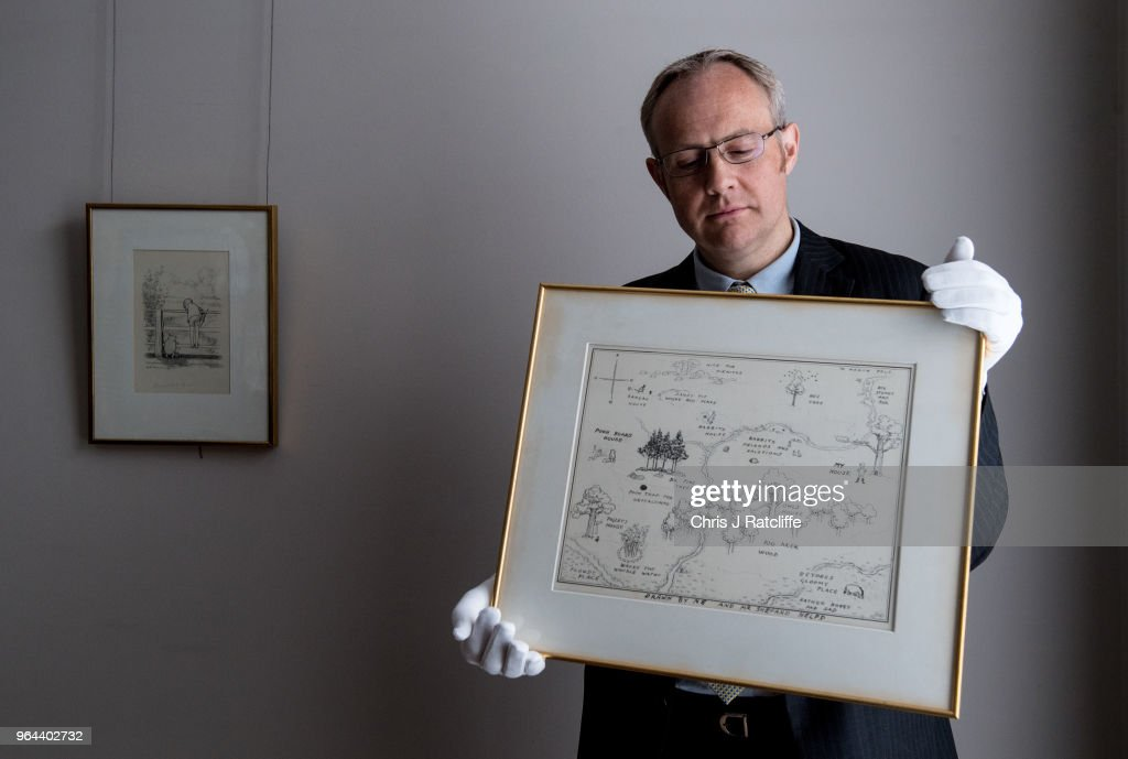 A Sotheby's employee holds 'The Original Map of the Hundred Acre Wood' by E.H. Shepard, estimated at £100,000 to £150,000, at the unveiling of original Winnie-The-Pooh sketches at Sotheby's on May 31, 2018 in London, England. The map has been unseen for almost half a century and is up for sale alongside four further long hidden original Winnie-The-Pooh illustrations at Sotheby's London on 10th July 2018.