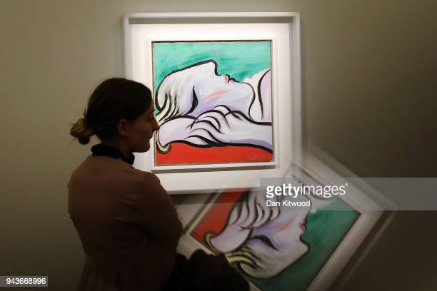 Sotheby's employee poses next to a painting by Pablo Picasso entitled 'Le Repos' 1932 during a UK preview of the 'Impressionist and Modern Art' sale...