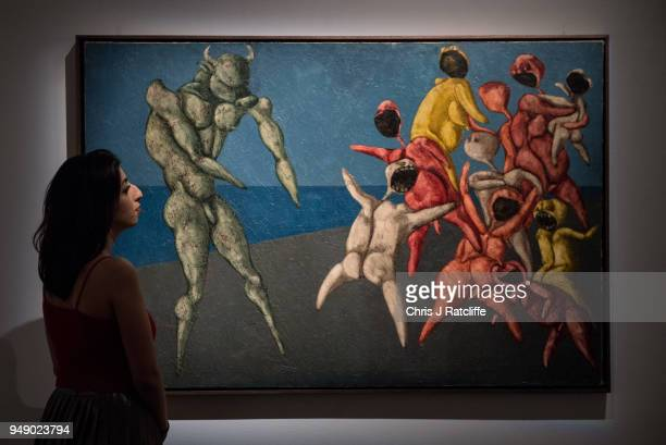 Sotheby's employee poses next to 'Il Minotauro fa Paura alla Gente per Bene' by Bahman Mohasses during a press preview of Orientilist and Middle...