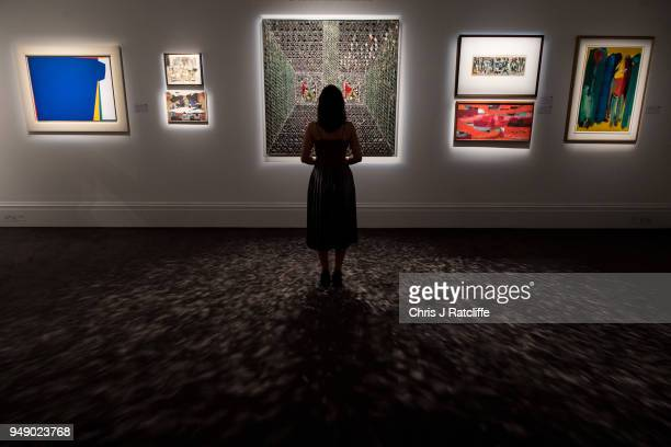 Sotheby's employee poses next to 'Recollections I' by Monir Farmanfarmaian during a press preview of Orientilist and Middle Eastern Art Week at...