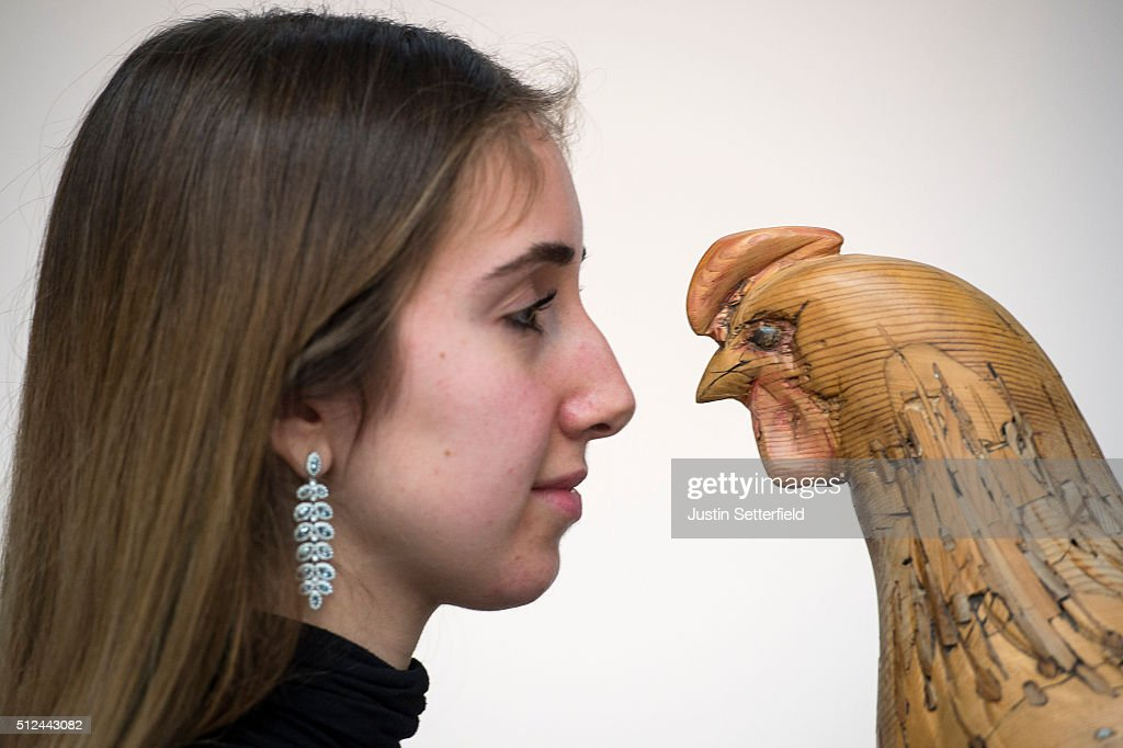 A Sotheby's employee stands next to a model of a hen by Nicholas Johnson during the pre-auction preview of the personal collection of Deborah Cavendish, Duchess of Devonshire at Sotheby's at Sotheby's on February 26, 2016 in London, England. The hen, which is made from reclaimed pine, was a gift from Andrew Cavendish, 11th Duke of Devonshire to the Duchess with an estimated auction value of £2,500-3,500. The youngest of the Mitford Sisters, and for half a century the chatelaine of Chatsworth, one of Englands greatest stately homes, Deborah Cavendish, Duchess of Devonshire was at the very heart of British rural, cultural and political life. The exhibition of her collection opens to the public on February 27, and the sale takes place on March 2, 2016.