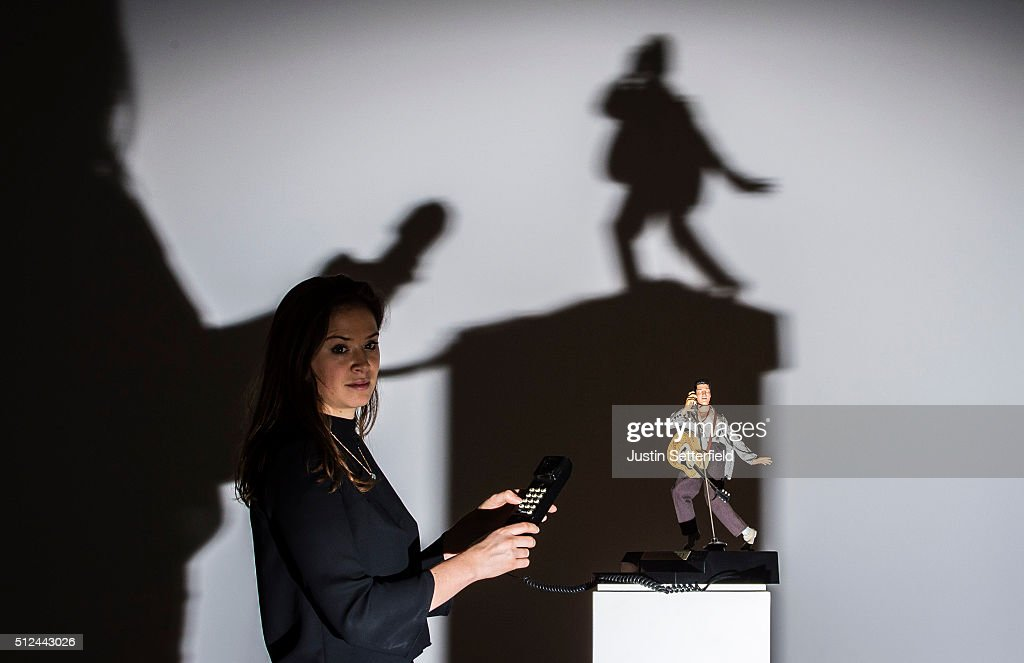 A Sotheby's employee stands with a novelty Elvis telephone during the pre-auction preview of the personal collection of Deborah Cavendish, Duchess of Devonshire at Sotheby's on February 26, 2016 in London, England. The telephone, previously installed in the Blue Drawing Room at Chatsworth, has an estimated auction price of £500-1,000. The youngest of the Mitford Sisters, and for half a century the chatelaine of Chatsworth, one of Englands greatest stately homes, Deborah Cavendish, Duchess of Devonshire was at the very heart of British rural, cultural and political life. The exhibition of her collection opens to the public on February 27, and the sale takes place on March 2, 2016.