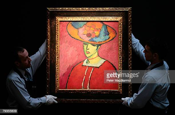 Sotheby's employees position Alexej von Jawlensky's 'Schokko With Wide Brimmed Hat' estimated at 6.5-8.5 million GBP at Sotheby's on January 29, 2008...