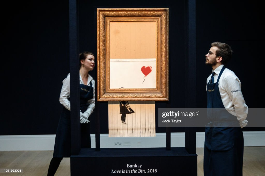 Sotheby's Unveils Banksy's Newly Completed Artwork 'Love in in the Bin' : News Photo