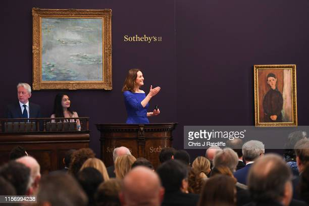 Sotheby's European Chairman and auctioneer Helena Newman fields bids at Sotheby's flagship Impressionist Modern Art sale in London tonight Monet's...