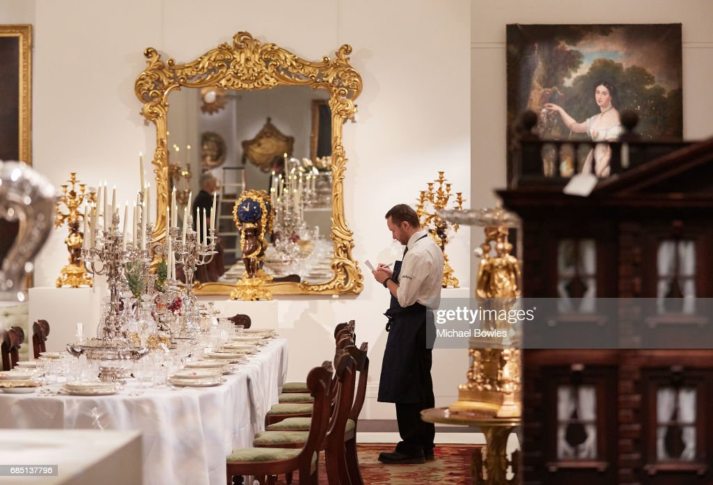 A Sotheby's technician takes stock of the objects on display as part of the Ballyedmond Collection at Sotheby's on May 19, 2017 in London, England.