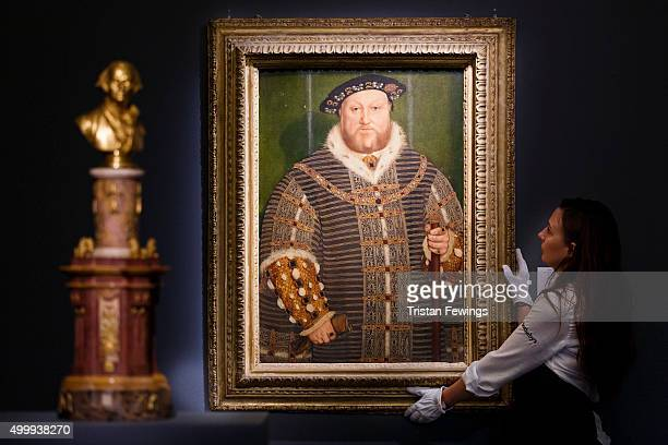 Sotheby's technicians install one of the greatest portraits of Henry VIII ever to emerge onto the market at Sotheby's on December 4 2015 in London...