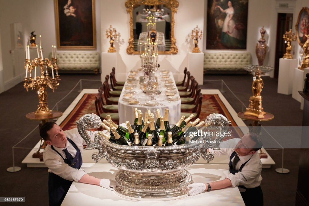 Sotheby's technicians position a silver wine cistern weighing over 70kg, holding bottles of champagne as part of the Ballyedmond Collection at Sotheby's on May 19, 2017 in London, England.
