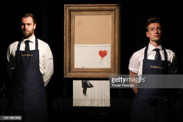 Sotheby's unveils Banksy's newly-titled 'Love is in the Bin' at Sotheby's on October 12, 2018 in London, England. Originally titled 'Girl with...