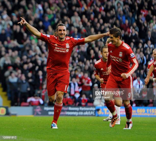 Sotirios Kyrgiakos of Liverpool celebrates his goal with Fernando Torres during the Barclays premier league match between Liverpool and Blackburn...