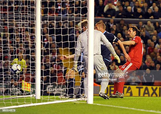 Sotirios Kyrgiakos of Liverpool scores Liverpool's third during the Barclays Premier League match between Liverpool and West ham United at Anfield on...