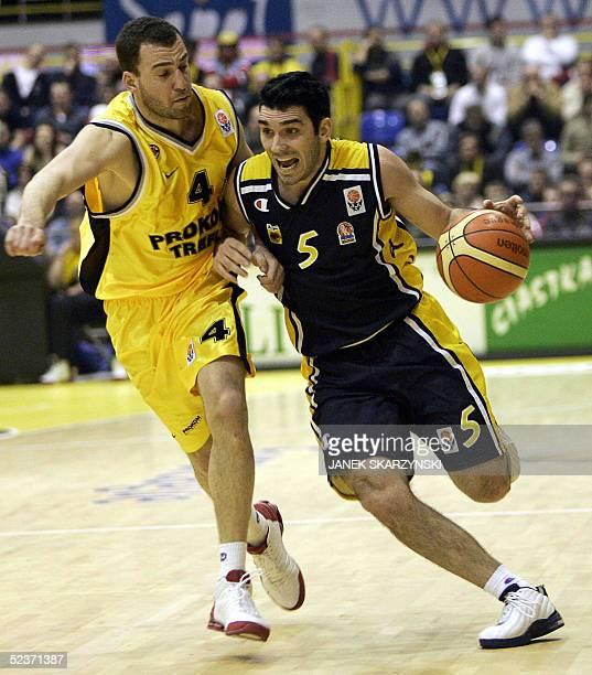 Sotiris Nikolaidis from AEK Athens vies with Istvan Nemeth from Prokom Trefl Sopot during Euroleague Top 16 group G basketball match 10 March 2005 in...